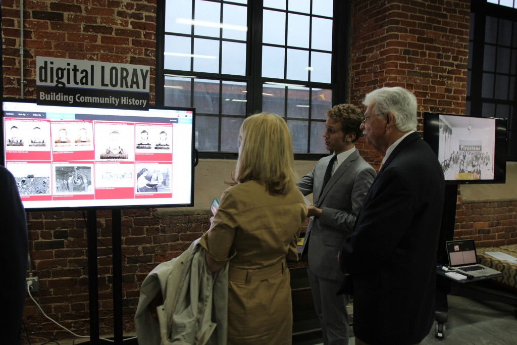 Elijah Gaddis demonstrates the digital archive, a part of Digital Loray.