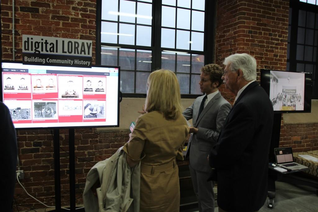 Elijah Gaddis demonstrates the digital archive, a part of Digital Loray.